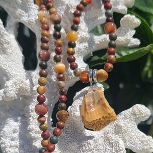 Jewelry - Beaded necklace with coral pendant